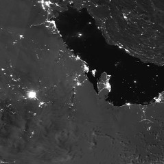 Smoke from Burning Refineries at Night (sjrankin) Tags: 16september2019 edited nasa usgs noaa smoke fire saudiarabia oilrefinery grayscale citylights suominpp 14september2019
