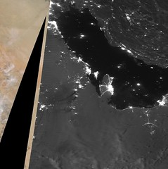 Smoke from Burning Refineries at Night (sjrankin) Tags: 16september2019 edited nasa usgs noaa smoke fire saudiarabia oilrefinery grayscale citylights suominpp 15september2019