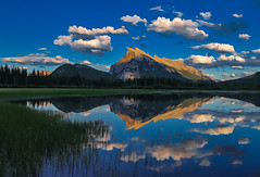Mt Rundle and  clouds (Robert Grove 2) Tags: clouds banff lake nature blue reflections reeds mountains canada alberta landscape
