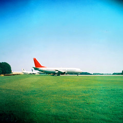 Ricoh Auto 126 (camera_holic) Tags: expired vignette ricoh auto 126 vintage old retro camera cartridge boots colour c41 high definition square format film analogue kemble cotswold airfield airport scrap boeing 737 jet2 belfast apron through fence jet plane glos gloucestershire