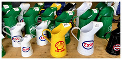 Fluctuating Oil Prices! [Explored] (The Stig 2009) Tags: thestig2009 thestig stig 2009 2019 tony o tonyo oil cans petrol stations display apple iphone 8 plus esso shell land rover harleydavidson yellow white green