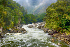 Down A River In Peru (Tarq Photography) Tags: river rocks peru flowing stream trees green leaves mountains clouds water