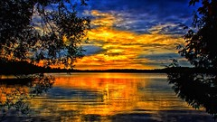 Framed by Nature - But I pushed the Button (Bob's Digital Eye 2) Tags: bobsdigitaleye2 canon clouds efs1855mmf3556isii fillinflash lake lakesunsets lakescape minnesota reflections sep2019 silhouette sky sun sunset sunsetsoverwater t3i landscapes flickr flicker