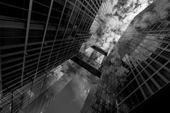 The house is glass II (rainerralph) Tags: wideangle glassfacade sonyalpha weitwinkel fassade fe281635gm wolken schwarzweiss facade sony glasfassade blackandwhite a7r3 clouds