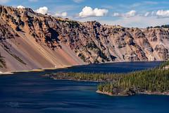 Caldera Rim of Crater Lake (TierraCosmos) Tags: craterlake craterlakenationalpark bestshotoftheday landscape lake caldera island wizardisland forest bluewater oregon centraloregon clouds