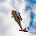 PANNING A KNIGHTHAWK OF NAS WHIDBEY SAR UNDER THE CLOUDS