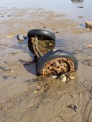 Encrusted With Rocks (Glass Horse 2017) Tags: cleveland saltburnbythesea seaside beach seaweed shadows rocks encrusted axle tyres rubber sea lowtide rust pebbles