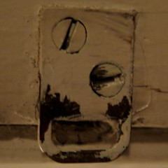 Gross!!! (Coyoty) Tags: macromondays pareidolia macro square screws face disgust horror gross expression lines lock latch rectangle black ochre yellow round circle metal squareformat paint beige anger humor doorway
