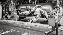 sleeping off ... (Gerard Koopen) Tags: malaga espana spain urban wallpainting streetart sleepingoff drunk passingby woman blackandwhite monochrome noir blackandwhiteonly street streetphotography ricoh griii 2019 gerardkoopen gerardkoopenphotography