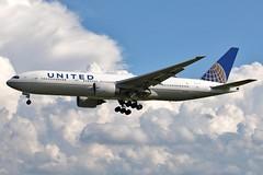 N37018 UNITED 777-224ER at KCLE (GeorgeM757) Tags: united 777 777224er n37018 aircraft aviation airplane boeing widebody kcle georgem757 storms clouds landing canon70d