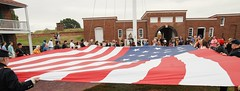 Attendees at the 2019 Defenders Day activities at Fort McHenry in Baltimore helping to raise the large American flag that will fly over the Fort on this day. (Bill A) Tags: warof1812 defendersday baltimore starsandstripes americanflag starspangledbanner oldglory fortmchenry