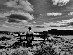 Watching the clouds drift by (Tobymeg) Tags: clouds troston hill southwest scotland watching drift by sky view seat black white time mono dumfries galloway criffel wife bench