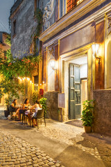 Trastevere Blue Hour (kinoalyse) Tags: ancient apartment architecture artificiallight bar beautiful building busy cafe city cobblestone colorphotography cuisine destination dusk eatery eating enjoy europe evening exterior food fun happy italian italy ivy july lamppost landmark lazio local neighborhood night noisy old outdoor peaceful people portrait restaurant road roman rome shop store street streetlamp summer sunset table tour tourism tourist tourists trastevere travel vertical