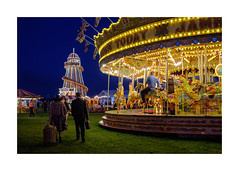 Time for home (realjv) Tags: 2019 goodwood goodwoodmotorcircuit xf23mmf2 carousel couple dusk fuji fujifilm funfair goodwoodrevival helterskelter night overtheroad vintage xpro2