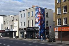 2019-07-01: Football Painting (psyxjaw) Tags: london londonist street art graffiti football advert painted side shop commercialroad shadwell