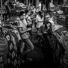 Sukawati market, Bali, Indonesia (pas le matin) Tags: bw nb blackandwhite noiretblanc travel monochtome monochrome voyage world market marché sukawati asia asie indonesia indonésie bali portrait woman femme candid street sukawatimarket pasarsenisukawati clothes vêtements souteastasia canon 7d canon7d canoneos7d eos7d