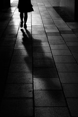 girl (radek_k_) Tags: girl woman outside street streetphoto streetphotography urban urbanandstreet lights shadows blackandwhite bw bnw olympus mzuiko omd people