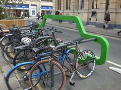 Promenade, Cheltenham - green bike rack (ell brown) Tags: greatbritain trees england tree bike bicycle unitedkingdom bikes gloucestershire bicycles promenade cheltenham bikerack spatown cheltenhamspa promenadecheltenham greenbikerack boots hsbcuk shop shops