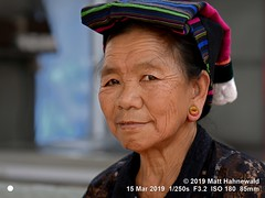 2019-03a Burma (14) (Matt Hahnewald) Tags: matthahnewaldphotography facingtheworld qualityphoto people character head face eyes ear earlobe earlobeplugs livedinface wrinkles expression lookingcamera eyecontact headwear headdress headscarf consensual dignity conceptual diversity humanity ethnic tribal minority hilltribe traditional cultural grandmother mandalay myanmar burma palaung palong tribe asia asian person one female adult elderly old woman women portraiture nikond610 nikkorafs85mmf18g 85mm 4x3ratio resized 1200x900pixels horizontal street portrait closeup headshot twothirdview sidewaysglance indoor availablelight colour posing authentic content elegant