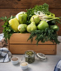 Vegan food. Fresh green hypoallergenic vegetables for detox in wooden box and the seeds. Selective focus (Radiomarlena) Tags: green food hypoallergenic background healthy organic vegetable fresh collection cucumber group raw vegetarian apple lettuce agriculture diet cabbage parsley salad onion eating wood fruit ingredient harvest dill natural pepper nutrition freshness vitamin assortment various kitchen snack vegan dietary health meal bell grocery zucchini set wooden squash pear sesame chia pumpkinseeds