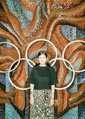 tania r. offside2019. kyiv. (Yaroslav F.) Tags: olympic rings metro station kyiv mosaic metal portrait flower girl 35mm halfframe half frame vertical tatoo yaroslav futymskyi