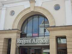 Regent Arcade - High Street, Cheltenham (ell brown) Tags: cheltenham cheltenhamspa gloucestershire england unitedkingdom greatbritain spatown tree trees highst highstcheltenham regentarcade sign