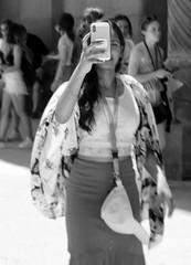 Shooting me shooting her - Sagrada Familia, Barcelona, Spain (TravelsWithDan) Tags: woman phone camera photography streetphotography europe spain barcelona sagradafamilia theotherphotographer candidportrait outdoors city urban bw blackandwhite monochrome canong3x