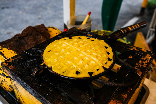 Fried pancake on old stove and pan