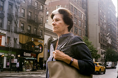 passing by (gguillaumee) Tags: film analog grain fujisuperia woman nyc newyorkcity candid streetphotography street leica leicam7 summicron 50mm 35mm color colorfilm