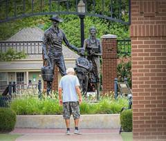 Honor Lane (clarkcg photography) Tags: man park centennialpark names honor statue rooster family 100years streetphotography streetphotography2019x