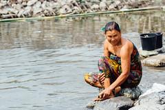 Woman Scrubbing Foot at River, Saw Myanmar (AdamCohn) Tags: adam cohn burma chauk myanmar bath bathe bathing laundry river streetphotographer streetphotography washing wwwadamcohncom adamcohn