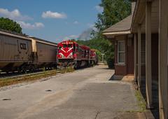 Passing through Trenton (ajketh) Tags: wtnn c307 west tennessee railroad trenton siding tn grain load csxt hopper notch echo 5517 5543 freight train ge general electric bn burlington northern
