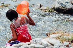 Woman Bathing with Bucket in River, Saw Myanmar (AdamCohn) Tags: adam cohn burma chauk myanmar bath bathe bathing bucket river streetphotographer streetphotography washing water woman wwwadamcohncom adamcohn