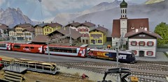 Glacier Express Arrives at Vals. (ManOfYorkshire) Tags: hom gauge 187 scale model train railway layout shipley exhibition 2019 glacierexpress swiss switzerland station show passenger freight fictitious