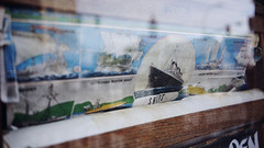 """Ships"" (Eric Flexyourhead) Tags: bellingham whatcomcounty washington usa downtown westhollystreet pennylaneantiquemall city urban detail fragment shop store window display windowdisplay windowdressing antique antiques antiqueshop antiquestore poster ship ships 169 sonyalphaa7 zeisssonnartfe35mmf28za zeiss 35mmf28"