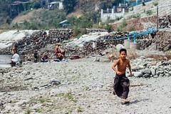 Boy in Longyi Running Along River (AdamCohn) Tags: adam cohn burma chauk myanmar bath bathe bathing laundry river streetphotographer streetphotography washing wwwadamcohncom adamcohn