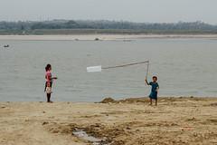 Plastic Bag Kite, Chauk Myanmar (AdamCohn) Tags: adam cohn burma chauk myanmar children kite plasticbag river streetphotographer streetphotography wwwadamcohncom adamcohn