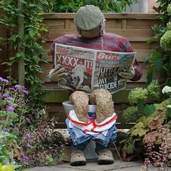 preoccupied - explored (quietpurplehaze07) Tags: scarecrow droxford newspaper