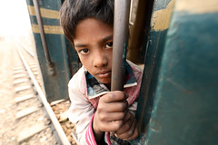Bangladesh, street boy on a train in Dhaka (Dietmar Temps) Tags: abandoned asia bangladesh boy child culture developingcountry dhaka homelessness human humanity kid loneliness male orphan outdoor people person poor poverty streetchildren streetkids streetyouth young nationalgeographicfacesoftheworld