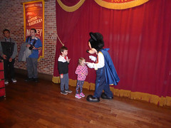 Florida Day 17 - 014 Magic Kingdom Town Square Theater Meeting Magician Mickey Mouse (TravelShorts) Tags: wdw walt disney world florida orlando magic kingdom disneys hollywood studios meet characters character greet meeting tinkerbelle tinker belle mickey mouse theatre town square funnel cake food dining caseys corner hot dog sofia first vampirina doc mcstuffins star wars bb8 galaxy far away one mans dream toy story land slinky dash andys lunchbox cinderellas royal table snow white ariel jasmine aurora happily ever after fireworks travel travelshorts day 17