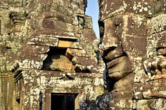 Buddha faces on ancient stone temple towers of Bayon in Angkor Thom, Cambodia (German Vogel) Tags: stonecarving statue buddha shrine stonetemple bayon mahayanabuddhism mahayana angkorthom galleriedtemple travel tourism traveldestinations touristattractions famousplace cambodia asia southeastasia holidaydestinations siemreap siemreapprovince angkor unescoworldheritagesite cultures khmer architecture ancient ancientcivilization oldruin archaeology ruined morning early locallandmark nationallandmark buddhisttemple hindutemple buddhism hinduism 12thcentury khmerempire khmerarchitecture templemountain