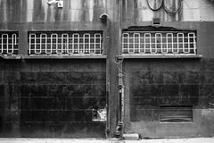 Surveillance (Tom Levold (www.levold.de/photosphere)) Tags: xpro2 xf18135mm fuji sw bw fassade facade decay verfall grid gitter