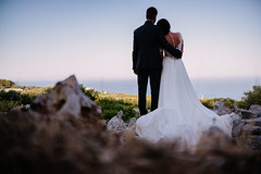 Bride & Groom At Sea (SplitShire) Tags: wedding fashion sky girl nature love water field mountain sea man photography woman standing bride rock outdoors photograph outdoor romance dress person clothing groom marriage engagement seashore gown veil weddingdress robe suit