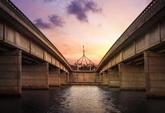 Parliament House (justarandomlad) Tags: canberra australia parliament house act sunset water bridge orange purple