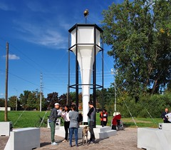 Observatory for Riparian Repose [In Reaching, the Sun collapsed into the Sea] - art installation (edk7) Tags: olympuspenliteepl5 edk7 2018 canada ontario peelregion mississauga clarkson southdown clarksonindustrialquarter southdownindustrialquarter mississaugasofthenewcreditfirstnationterritory theworkofwindairlandsea contemporaryartfestival climatechange environmentalcrisis environmentalresilience blackwoodgallery universityoftorontomississauga cityofmississauga observatoryforriparianreposeinreachingthesuncollapsedintothesea pejvakrouzbehakhbarifelixkalmenson artinstallation tower stays sculpture symbol pool people person tree sky grass city cityscape urban culture openairmuseum