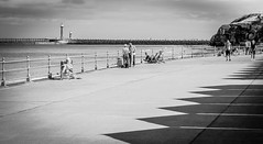 Whitby . (wayman2011) Tags: colinhart fujifilm50mmf2 fujifilmxt1 lightroom5 wayman2011 bw mono coast seaside promenades piers lighthouses people northyorkshire whitby uk