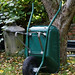 Green wheel barrow at Nuthurst West Sussex England