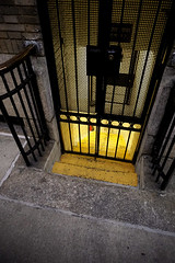 The Glow Beneath (Restless Eye) Tags: newyorkcity newyork usa stairs wroughtiron light below doorway
