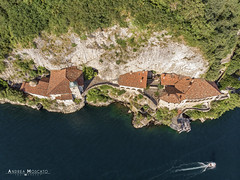 Eremo di Santa Caterina del Sasso - Leggiuno (Italy) (Andrea Moscato) Tags: andreamoscato italia montagna landscape light luce paesaggio shadow nature natura natural naturale view vista vivid day panorama lago lake water freshwater ombre yellow mountain boat orange house architecture architettura art overlook fly drone dji mavic air quadcopter blue dark deep buildings monte pier monument roof monastero green trees rock cliff white yacht
