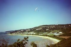 Beach Paragliding (hiphopmilk) Tags: copyright©jaredyehwooehmoehfilms film analog analogue 35mm 135film konica offroad zoom 現場監督 kodakfilm kodak travel japan nanjo jaredyeh hiphopmilk capechinen paragliding paraglide paraglider fly sky sea beach ocean coast shore